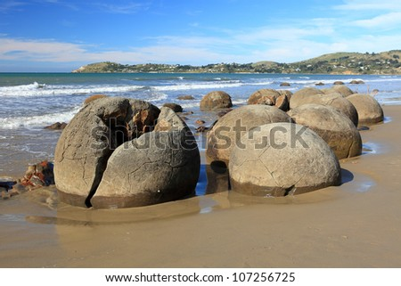 Moeraki boulders on Koekohe Beach, New Zealand - stock photo