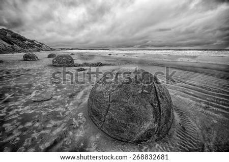Moeraki Boulders on the Koekohe beach, Eastern coast of New Zealand. HDR image, black and white - stock photo
