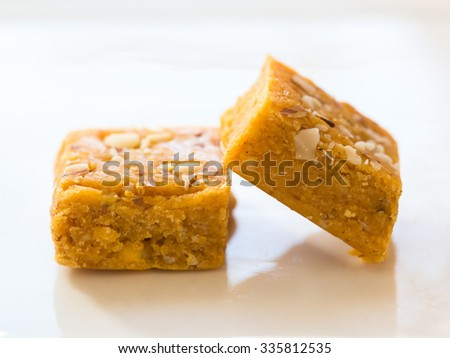Mohanthal is a sweetened gram flour fudges made with Ghee, and flavored with saffron and almonds. It is a traditional Gujarati sweet quite popular during festivals, mainly Diwali - stock photo