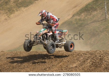 "MOHELNICE, CZECH REPUBLIC - APRIL 25. Racer is jumping a quad bike in the ""International Championship of Czech Republic in Quad 2015"" on April 25. 2015 in Mohelnice. - stock photo"