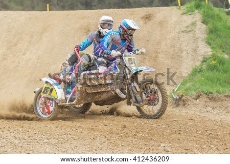 """MOHELNICE, CZECH REPUBLIC - APRIL 23. Sidecar accelerating in the turn in the """"Crossracing cup 2016- Sidecars Championship of Czech Republic"""" on April 23. 2016 in Mohelnice. - stock photo"""