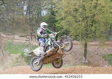 "MOHELNICE, CZECH REPUBLIC - APRIL 23. Sidecar is high jumping in the race named ""Crossracing cup 2016- Sidecars Championship of Czech Republic"" on April 23. 2016 in Mohelnice. - stock photo"
