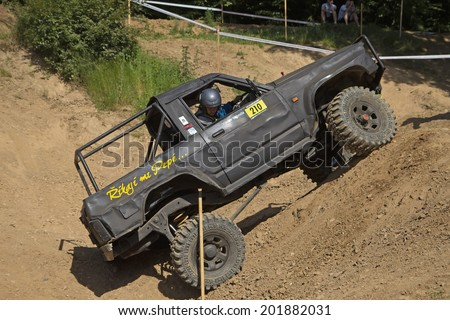 "MOHELNICE,  CZECH REPUBLIC - JUNE 07: Black car is hitting a steep hill in the ""Championship of the Czech Republic in the off road tech trial-2014"" on June 07, 2014  in MOHELNICE, Czech Republic."