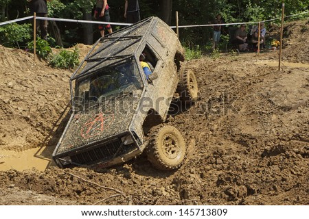 """MOHELNICE, CZECH REPUBLIC - JUNE 09. Off road car stuck in a muddy terrain in the """"BIG SHOCK CUP Trial 2013"""" on June 09, 2013  in the town of Mohelnice, Czech Republic.  - stock photo"""