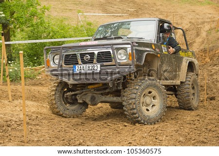 "MOHELNICE, CZECH REPUBLIC - JUNE 10. Unidentified racer at off-road car in difficult muddy terrain in the ""SHOCK CUP Trial 2012"" on June 10, 2012 in the town of Mohelnice, Czech Republic. - stock photo"