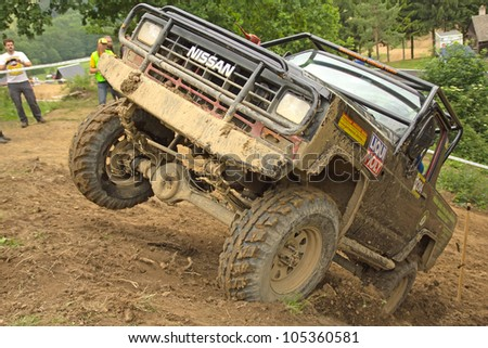 "MOHELNICE, CZECH REPUBLIC - JUNE 10. Unidentified racer at off-road car leaves steep slope in the ""SHOCK CUP Trial 2012"" on June 10, 2012 in the town of Mohelnice, Czech Republic. - stock photo"
