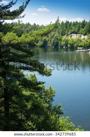 Mohonk Lake with dock, surrounded by mountains. - stock photo