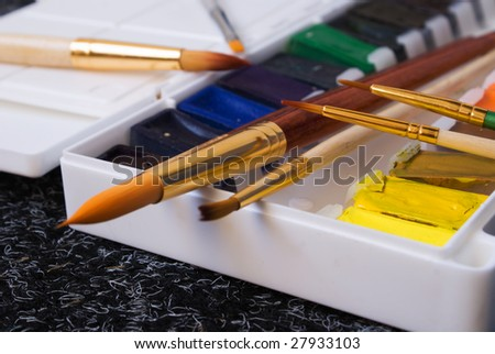 Moist colours and brushes - stock photo
