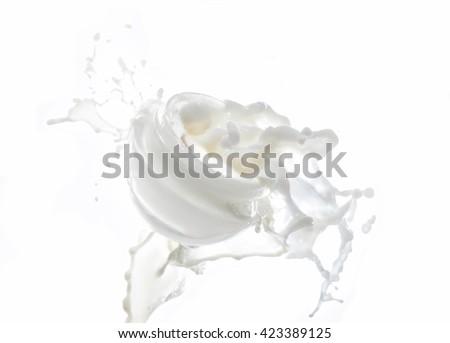 Moisturizing cream, moisturizing milk in the big milk splash isolated on the white background with milk drops and splashes around the jar - stock photo