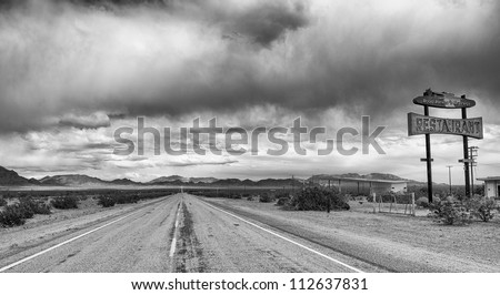 MOJAVE DESERT, CA, USA - APRIL 8: Abandoned gas and food stop on Route 66 on April 8,2011 in Mojave desert, CA.  Route 66 is a historic highway famous from literature and popular culture. - stock photo