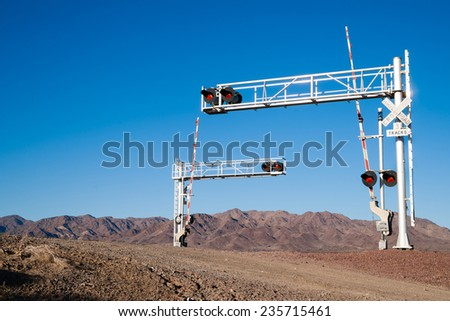 Mojave Desert Railroad Crossing Three Tracks Warning Lights - stock photo