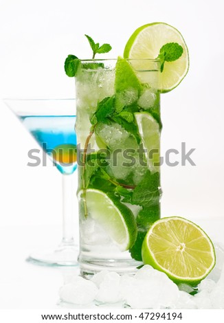 Mojito and blue lagoon cocktails on isolated white background - stock photo