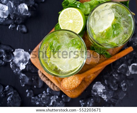 Mojito and ingredients, dark background