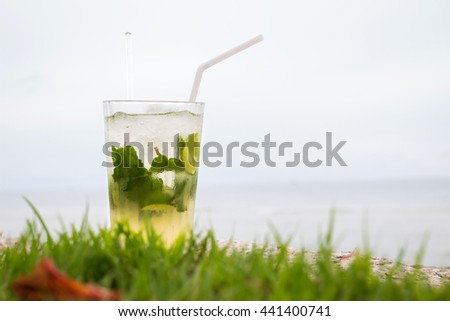 Mojito chilling on the beach - stock photo