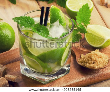 Mojito cocktail and fresh ingredients. Selective focus - stock photo