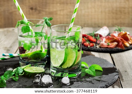 Mojito cocktail and ingredients - stock photo