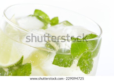 Mojito cocktail closeup on a white background - stock photo