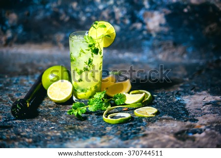 Mojito cocktail in a bar on a metal table, selective focus and details - stock photo