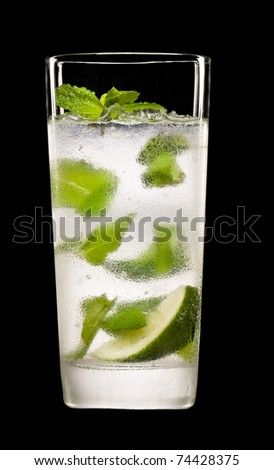Mojito cocktail in front of a black background - stock photo
