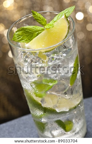 Mojito Cocktail in front of a nice colored background - stock photo