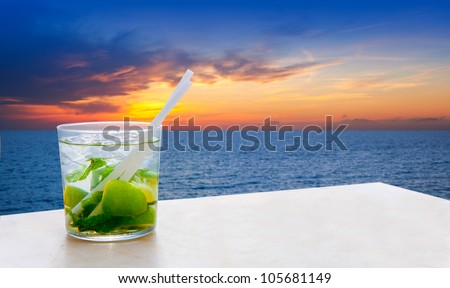 Mojito cocktail on a sunset beach golden red sky sunrise [ photo-illustration]
