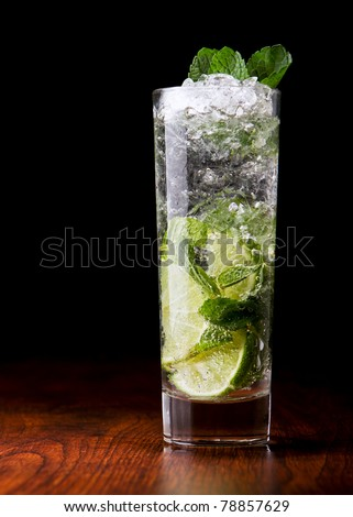 Mojito Cocktail on a wooden table - stock photo