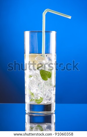 Mojito cocktail on blue background - stock photo