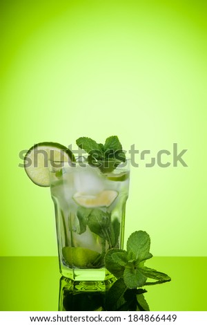 mojito cocktail on green background - stock photo