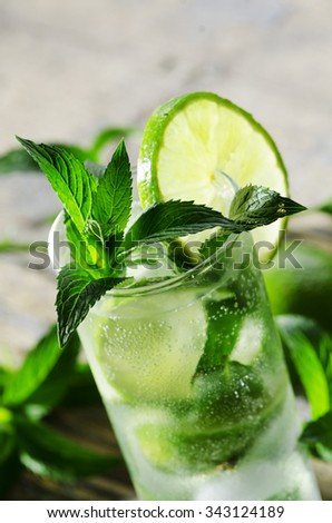Mojito cocktail on wooden table closeup - stock photo
