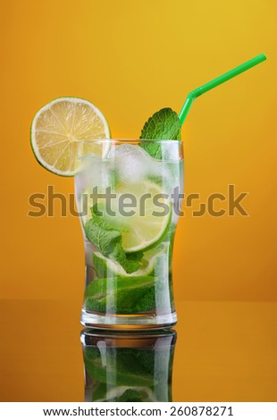 Mojito  cocktail. on yellow background. - stock photo
