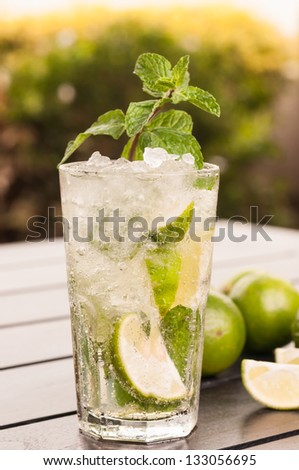 Mojito cocktail outdoor close up in the afternoon, a Cuban cocktail made with cuban rum, lime, sugar and a splash of soda - stock photo