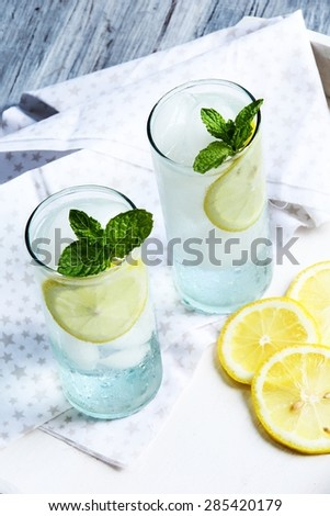 Mojito cocktail served in tall glass, selective focus - stock photo