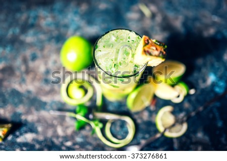 mojito cocktail with close-up ice details and metal blue background served cold in pub or restaurant