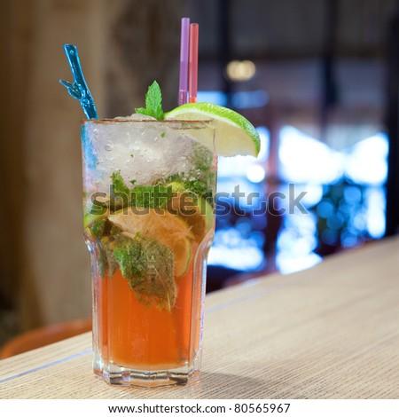 Mojito cocktail with cold tea - stock photo