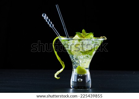 Mojito cocktail with fresh lime  - stock photo