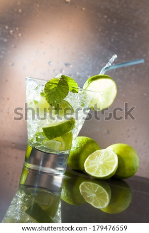 Mojito cocktail with fresh lime at the club