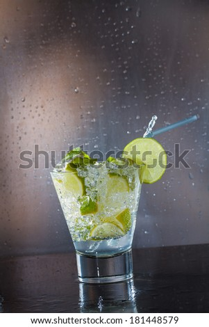 Mojito cocktail with fresh lime at the club - stock photo