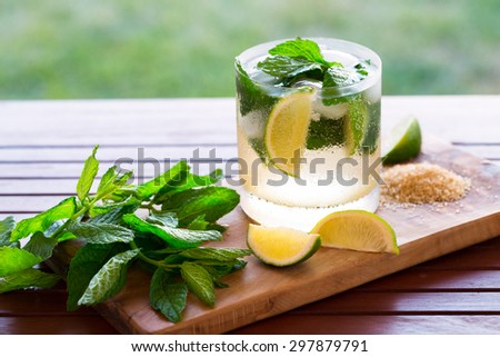 Mojito cocktail with fresh mint, lime and brown sugar - stock photo