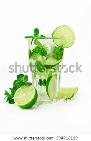 Mojito cocktail with lime and mint in tumbler glass on white background - stock photo