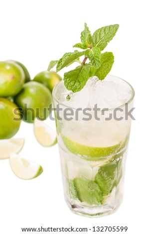 Mojito cocktail with limes background on a white background, a Cuban cocktail made with cuban rum, lime, sugar and a splash of soda - stock photo