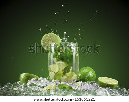Mojito cocktail with splash and ice - stock photo