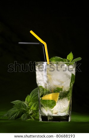 mojito, drink with mint leaves on a dark background - stock photo