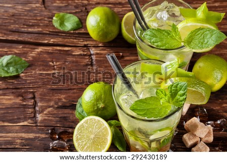 Mojito drinks served on wooden planks - stock photo