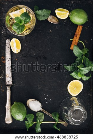 Mojito ingredients on black rustic background. Top view frame design with copyspace.