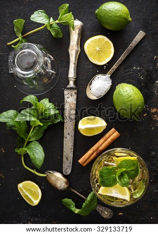 mojito ingredients on rustic black background - stock photo
