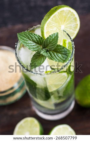 Mojito Lime Drink Cocktail on Wooden Table from Above - stock photo