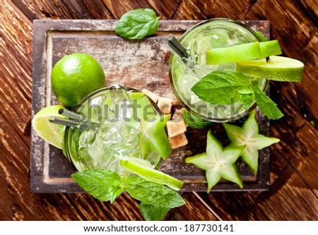 Mojito lime drinks on wooden background, upper view - stock photo