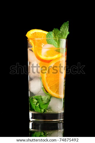 Mojito orange cocktail  on black background. - stock photo