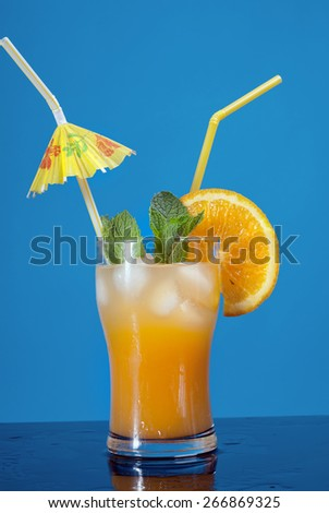 Mojito orange cocktail.on blue background. - stock photo