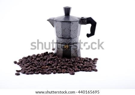 moka pot Espresso pot and coffee beans  - stock photo